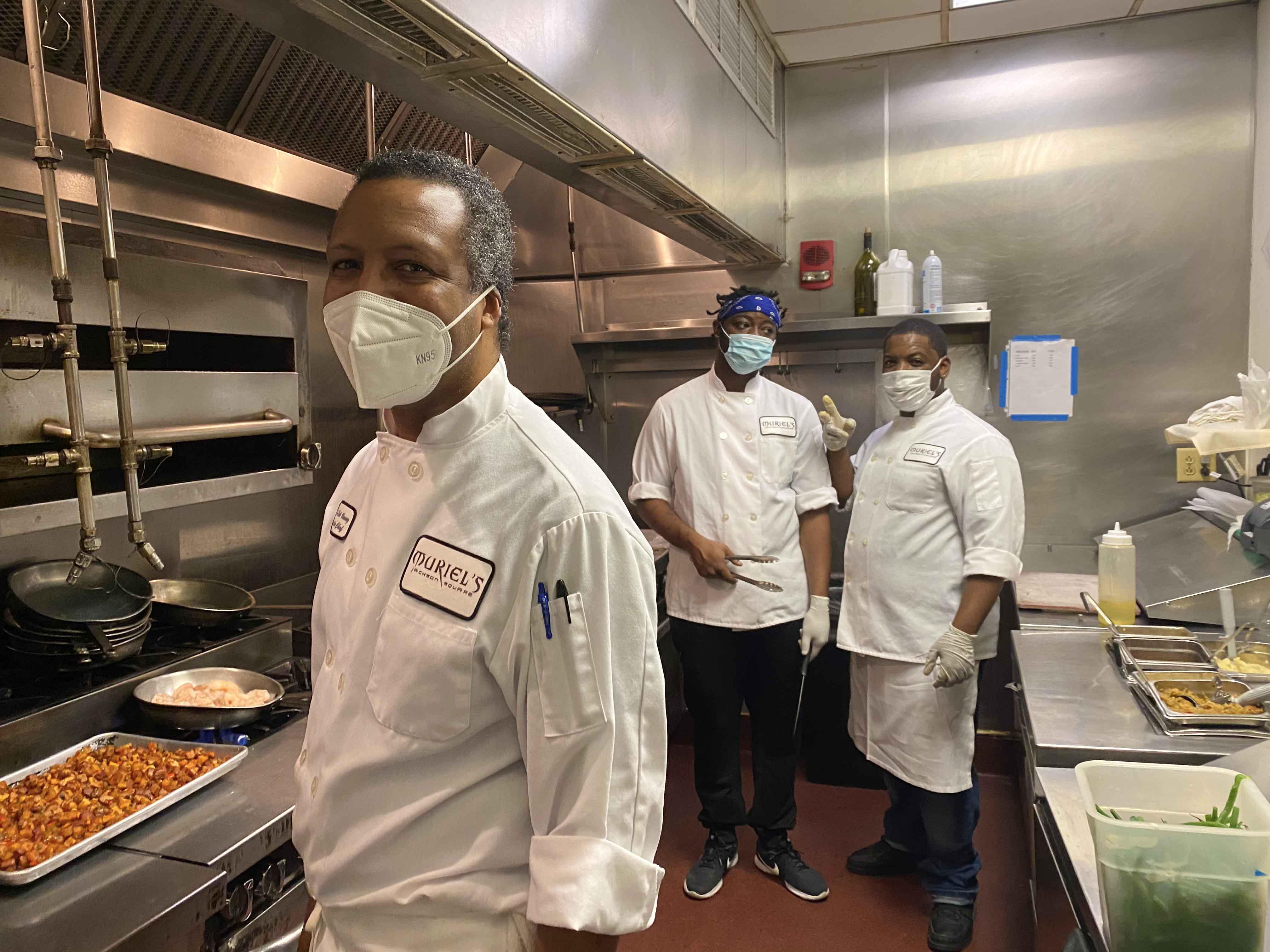 Masked Cooks in Kitchen